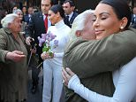 Kim Kardashian meets and hugs and gets kisses from her oldest Armenian fan that waited 12 hours a day to finally see her in Yerevan City. The woman had stood on her feet each day using her cane as Kim was very touched by the moment and her will and deterimination to meet her. Kim let her hug her and even hand her a flower as Khloe was laughing in the moment. A giant baby North West photo was in the middle of the crowd as Khloe signed autographs and later Kim went over to some young fans to sign and pose for photos with them while wearing a tight all white look.\n\nPictured: Kim Kardashian, Khloe Kardashian, Armenian fan\nRef: SPL996923  120415  \nPicture by: Brian Prahl / Splash News\n\nSplash News and Pictures\nLos Angeles: 310-821-2666\nNew York: 212-619-2666\nLondon: 870-934-2666\nphotodesk@splashnews.com\n