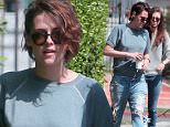"""Picture Shows: Kristen Stewart, Friend  April 10, 2015\n \n """"Twilight"""" star Kristen Stewart makes a morning coffee run with a group of friends in Los Feliz, California. Kristen looked casual in a sweater and distressed jeans.\n \n Exclusive All Rounder\n UK RIGHTS ONLY\n Pictures by : FameFlynet UK © 2015\n Tel : +44 (0)20 3551 5049\n Email : info@fameflynet.uk.com"""