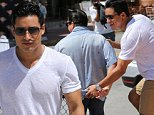 April 11, 2015: Extra host Mario Lopez shows off his cute dimples as he  playfully grabs his male friend's behind during the Miami Beach Gay Pride Festival. Mario is in town to make appearances and serve as the Grand Marshal during the Miami Beach Gay Pride Parade.\nMandatory Credit: INFphoto.com Ref: infusmi-11/13