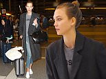 10.APR.2015 - LOS ANGELES - USA ** EXCLUSIVE ALL ROUND PICTURES ** SUPERMODEL KARLIE KLOSS STROLLS WITH HER LUGGAGE THROUGH LAX TODAY AS SHE GETS SET TO TAKE FLIGHT.  THE FRESH FACED BEAUTY SHARED A FLIRTATIOUS SMILE FOR THE CAMERA BEFORE HEADING THROUGH SECURITY BYLINE MUST READ : XPOSUREPHOTOS.COM *AVAILABLE FOR UK SALE ONLY* ***UK CLIENTS - PICTURES CONTAINING CHILDREN PLEASE PIXELATE FACE PRIOR TO PUBLICATION *** *UK CLIENTS MUST CALL PRIOR TO TV OR ONLINE USAGE PLEASE TELEPHONE 0208 344 2007*