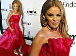 Australian singer Kylie Minogue poses upon arrival at the Foundation for AIDS Research (amfAR) fund raising gala in Sao Paulo April 10, 2015. REUTERS/Paulo Whitaker