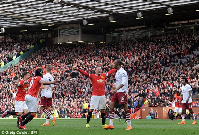 Rooney celebrates as his team-mates Ander Herrera (left) and Radamel Falcao run to join him