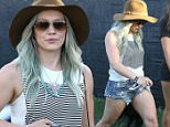 Indio, CA - Actress and singer Hilary Duff attends day two on the first week of Coachella in Indio.  The pretty mama was spotted walking with a friend and kept her face shielded from the sun with an oversized floppy hat and sunglasses.  \n  \nAKM-GSI      April 11, 2015\nTo License These Photos, Please Contact :\nSteve Ginsburg\n(310) 505-8447\n(323) 423-9397\nsteve@akmgsi.com\nsales@akmgsi.com\nor\nMaria Buda\n(917) 242-1505\nmbuda@akmgsi.com\nginsburgspalyinc@gmail.com