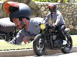 EXCLUSIVE: David Beckham pulls over to inspect his new Triumph motorcycle near his Beverly Hills home.  Pictured: David Beckham Ref: SPL975197  110415   EXCLUSIVE Picture by: Gracias / Splash News  Splash News and Pictures Los Angeles: 310-821-2666 New York: 212-619-2666 London: 870-934-2666 photodesk@splashnews.com