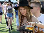 Behati Prinsloo having a blast at Coachella with some friends in tiny shorts making funny faces. april 11, 2015\nX17online.com\n