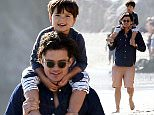 Premier Exclusive -Orlando Bloom spending the day with son Flynn goofing off  on the beach in Malibu  April 12th, 2015\nX17online.com\nNO WEBSITE USAGE\nNO MAGAZINE USAGE\nOK PAPER USAGE\nAny queries call X17 UK Office /0034 966 713 949/926 \nAlasdair 0034 630576519 \nGary 0034 686421720\nLynne 0034 611100011