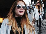 12.APRIL.2015 - LONDON - UK *EXCLUSIVE ALL ROUND PICTURES* AMERICAN ACTRESS LINDSAY LOHAN IS SEEN LEAVING THE  IVY RESTAURANT IN CHELSEA, LONDON ATER LUNCH. LINDSAY WAS WEARING THIGH HIGH WET LOOK LEG WARMERS OVER HER JEANS. BYLINE MUST READ : XPOSUREPHOTOS.COM ***UK CLIENTS - PICTURES CONTAINING CHILDREN PLEASE PIXELATE FACE PRIOR TO PUBLICATION *** **UK CLIENTS MUST CALL PRIOR TO TV OR ONLINE USAGE PLEASE TELEPHONE 0208 344 2007**