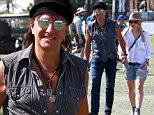 Indio, CA - Rocker Richie Sambora and girlfriend Orianthi hold hands as they make their way around the ground during day day 3 of the Coachella Music Festival.  Richie and Orianthi had a few friends with them and also had daughter Ava tag along with a couple of her friends.\nAKM-GSI       April  12, 2015\nTo License These Photos, Please Contact :\nSteve Ginsburg\n(310) 505-8447\n(323) 423-9397\nsteve@akmgsi.com\nsales@akmgsi.com\nor\nMaria Buda\n(917) 242-1505\nmbuda@akmgsi.com\nginsburgspalyinc@gmail.com