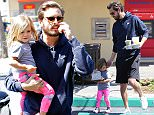 Scott Disick and daughter Penelope got out to ppick up some goodies at Coffee Bean in Calabasas.  Scott lets his adorable little girl carry two bags back to the car, before scooping her up in the parking lot, on Sunday, April 12, 2015 X17online.com
