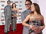 """Robert Downey Jr., left, and Susan Downey arrive at the Los Angeles premiere of """"Avengers: Age Of Ultron"""" at the Dolby Theatre on Monday, April 13, 2015. (Photo by Jordan Strauss/Invision/AP)"""