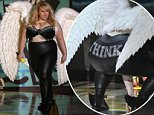 """Actress Rebel Wilson walks on stage to join her co-stars from """"Pitch Perfect 2"""" as they present an award at the 2015 MTV Movie Awards in Los Angeles, California April 12, 2015. REUTERS/Mario Anzuoni"""
