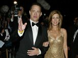 """Tom Hanks and Rita Wilson . CANNES, FRANCE - MAY 18: Actor Tom Hanks and his wife Rita Wilson attend """"The Ladykillers After Party"""" at Les Pecheurs during the 57th International Cannes Film Festival May 18, 2004 in Antibes, France. (Photo by Mark Mainz/Getty Images)  *** Local Caption *** Tom Hanks; Rita Wilson L'Oreal"""