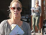 Picture Shows: Elizabeth Berkley  April 13, 2015    Actress and busy mom Elizabeth Berkley stops to grab some coffee while out and about in Los Angeles, California. It was a solo outing for Elizabeth who was seen without Sky, her two-year-old son she has with her artist husband Greg Lauren.    Exclusive All Rounder  UK RIGHTS ONLY    Pictures by : FameFlynet UK © 2015  Tel : +44 (0)20 3551 5049  Email : info@fameflynet.uk.com