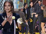 Actress Jennifer Lopez accepts the Best Scared as S#!T award during the 2015 MTV Movie Awards in Los Angeles, California April 12, 2015. REUTERS/Mario Anzuoni
