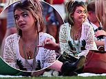 Sarah Hyland is all smiles when lying down on the grass with her friends at Coachella Music Festival in Indio, CA.  Pictured: Sarah Hyland Ref: SPL997813  120415   Picture by: Splash News  Splash News and Pictures Los Angeles: 310-821-2666 New York: 212-619-2666 London: 870-934-2666 photodesk@splashnews.com