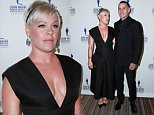 Pink and Corey Hart attend the John Wayne Cancer Institute Auxiliary 30th annual Odyssey Ball at Regent Beverly Wilshire Hotel on April 11, 2015 in Beverly Hills, California.  Pictured: Pink, P!nk, Carey Hart Ref: SPL995293  110415   Picture by: @Parisa/Splash News  Splash News and Pictures Los Angeles: 310-821-2666 New York: 212-619-2666 London: 870-934-2666 photodesk@splashnews.com