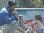 David and Harper Beckham enjoy a cool treat in Los Angeles, CA.  Pictured: David Beckham and Harper Beckham Ref: SPL996874  130415   Picture by: DutchLabUSA / Splash News  Splash News and Pictures Los Angeles: 310-821-2666 New York: 212-619-2666 London: 870-934-2666 photodesk@splashnews.com