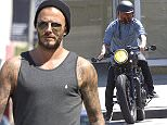 David Beckham stops off for a health shake with a friend on 3rd street in West Hollywood. He then drove off on his motorcycle Featuring: David Beckham Where: Los Angeles, California, United States When: 13 Apr 2015 Credit: Owen Beiny/WENN.com