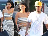 Picture Shows: Kylie Jenner  April 14, 2015    ** Min Web / Online Fee £150 For Set **    Reality star Kylie Jenner and her boyfriend Tyga out shopping in Hollywood, California. Kylie showed off her stomach in a striped crop top and matching skirt.    Exclusive All Rounder  UK RIGHTS ONLY    Pictures by : FameFlynet UK © 2015  Tel : +44 (0)20 3551 5049  Email : info@fameflynet.uk.com