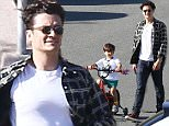 12.APRIL.2015 - MALIBU - USA  *EXCLUSIVE ALL ROUND PICTURES AVAILABLE FOR UK AND GERMANY ONLY* ENGLISH ACTOR ORLANDO BLOOM TAKES HIS SON FLYNN OUT TO PLAY AT THE PARK AND RIDE ON HIS BIKE IN MALIBU, CALIFORNIA. BYLINE MUST READ : XPOSUREPHOTOS.COM ***UK CLIENTS - PICTURES CONTAINING CHILDREN PLEASE PIXELATE FACE PRIOR TO PUBLICATION ***