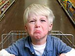 Boy crying in and having a tantum in shopping trolley.