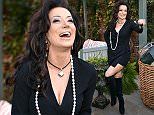 Mandatory Credit: Photo by Nick Harvey/REX Shutterstock (4662407at)  Nancy Dell'Olio  The Ivy Chelsea Garden Launch Party, London, Britain - 14 Apr 2015