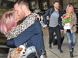 EXCLUSIVE: Julianne Hough all smiles as her boyfriend Brooks Laich picks her up at the airport in Washington, DC. Brooks ran up to Julianne as she arrived surprising her with flowers, they were both smiles ear to ear. Brooks and Julianne were kissing, Brooks gave Julianne's dogs a treat as well.   Pictured: Julianne Hough, Brooks Laich Ref: SPL980205  140415   EXCLUSIVE Picture by: Todd DC/ Splash News  Splash News and Pictures Los Angeles: 310-821-2666 New York: 212-619-2666 London: 870-934-2666 photodesk@splashnews.com