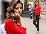 Camila Alves wears a red blouse with black skinny jeans while leaving an office building in Chelsea and arriving at Churrascaria Plataforma Brazilian steakhouse in Midtown, New York City on April 14, 2015.  Pictured: Camila Alves Ref: SPL998753  140415   Picture by: Felipe Ramales / Splash News  Splash News and Pictures Los Angeles: 310-821-2666 New York: 212-619-2666 London: 870-934-2666 photodesk@splashnews.com