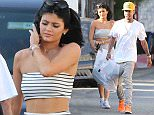 Picture Shows: Kylie Jenner, Tyga  April 14, 2015    ** Min Web / Online Fee £150 For Set **    Reality star Kylie Jenner and her boyfriend Tyga out shopping in Hollywood, California. Kylie showed off her stomach in a striped crop top and matching skirt.    Exclusive All Rounder  UK RIGHTS ONLY    Pictures by : FameFlynet UK © 2015  Tel : +44 (0)20 3551 5049  Email : info@fameflynet.uk.com
