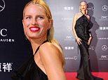 Model Karolina Kurkova arrives for the Laureus World Sports Awards 2015 in Shanghai April 15, 2015. REUTERS/Aly Song