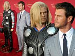 """HOLLYWOOD, CA - APRIL 13:  Actor Chris Hemsworth poses with his Madame Tussauds Hollywood figure at the """"Avengers: Age of Ultron"""" premiere at Dolby Theatre on April 13, 2015 in Hollywood, California.  (Photo by Chelsea Lauren/Getty Images for Madame Tussauds Hollywood)"""