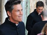 EXCLUSIVE: Rob Lowe was spotted in Valletta Malta today on the set of apocalypse slough. He is seen petting a dog with a nun having hair arranged and also smoking a cigarette. \n\nRef: SPL995710  130415   EXCLUSIVE\nPicture by: Mark ZC / Splash News\n\nSplash News and Pictures\nLos Angeles:\t310-821-2666\nNew York:\t212-619-2666\nLondon:\t870-934-2666\nphotodesk@splashnews.com\n