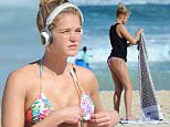 EXCLUSIVE 14 04 15 Sydney  NSW  A makeup free former Victorian Secret supermodel Erin Heatherton sun baking on Coogee Beach