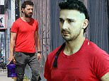 UK CLIENTS MUST CREDIT: AKM-GSI ONLY EXCLUSIVE: Shia LaBeouf hits the gym wearing feminine heart earrings and a new eyebrow piercing in West Hollywood, CA.  Pictured: Shia LaBeouf Ref: SPL999804  140415   EXCLUSIVE Picture by: AKM-GSI / Splash News