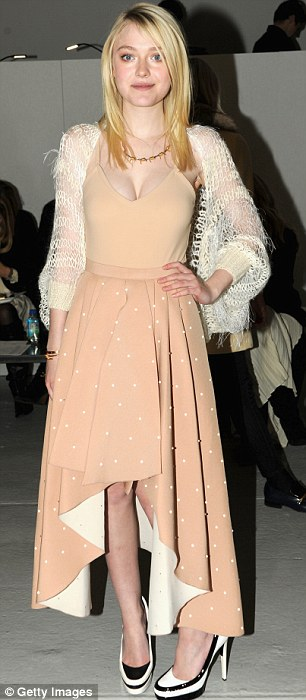 Pretty in pink: The 19-year-old donned a pale pink dress which featured a cleavage bearing top and a ruffled skirt with white polka dots