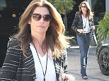 Please contact X17 before any use of these exclusive photos - x17@x17agency.com   Cindy Crawford got out to stretch her legs in Malibu.  The world famous supermodel wore a blazer and jeans with heels.   April 15, 2015 X17online.com