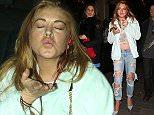 LONDON, ENGLAND - APRIL 15:  Lindsay Lohan leaving Cirque nightclub on April 15, 2015 in London, England.  (Photo by Mark Robert Milan/GC Images)