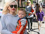Beverly Hills, CA - Gwen Stefani carries little Apollo as she goes on a shopping spree with Zuma and King, along with their inseparable nannies. Gwen, who is a fashion icon, wore a simple gray sweater with black leather trousers and Adidas sneakers. AKM-GSI          April 15, 2015 To License These Photos, Please Contact : Steve Ginsburg (310) 505-8447 (323) 423-9397 steve@akmgsi.com sales@akmgsi.com or Maria Buda (917) 242-1505 mbuda@akmgsi.com ginsburgspalyinc@gmail.com