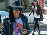 UK CLIENTS MUST CREDIT: AKM-GSI ONLY EXCLUSIVE: Expecting couple Naya Rivera and Ryan Dorsey have a lunch date at Yakuza Sushi in Silver Lake, Los Angeles on April 15, 2015. Naya showed off her growing belly in a loose t-shirt and leather jacket, while wearing comfortable leggings and Converse sneakers, as she lead the way back to their car after lunch.  Pictured: Naya Rivera Ref: SPL1000564  150415   EXCLUSIVE Picture by: AKM-GSI / Splash News