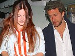 Lana Del Rey leaving dinner in stripes at Giorgio Baldi with an unknown man who is not her boyfriend.    April 15, 2015 X17online.com