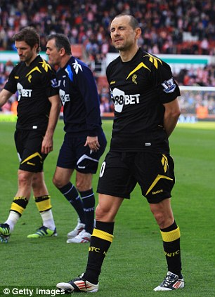 Wanderer winces: Martin Petrov closes his eyes after being relegated