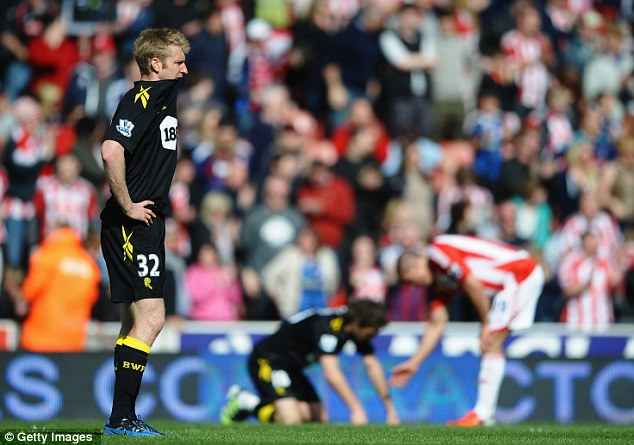 Field of screams: Tim Ream (left) knows it will be life in the Championship for Bolton