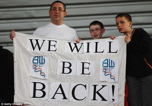 Trot-timistic: Trotters fans put on a brave face after seeing Bolton relegated
