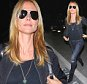 A pin thin Heidi Klum cute and casual  in jeans and a tee shirt flying to NYC alone April 15, 2015 X17online.com