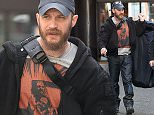 Picture Shows: Tom Hardy  April 17, 2015\n \n Actor Tom Hardy is seen leaving the Soho Hotel in London, England.\n \n The 'Child 44' actor was wearing a graphic print T-shirt under a black sweatshirt, blue denim jeans and trainers as he left the studio carrying a garment cover.\n \n Non Exclusive\n WORLDWIDE RIGHTS\n \n Pictures by : FameFlynet UK © 2015\n Tel : +44 (0)20 3551 5049\n Email : info@fameflynet.uk.com