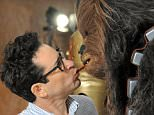 ANAHEIM, CA - APRIL 16:  Director J.J. Abrams and Chewbacca share a Twizzler on Day One of Disney's 2015 Star Wars Celebration held at the Anaheim Convention Center on April 16, 2015 in Anaheim, California.  (Photo by Albert L. Ortega/Getty Images)
