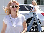UK CLIENTS MUST CREDIT: AKM-GSI ONLY EXCLUSIVE: 'Mad Men' beauty January Jones hit the streets of Beverly Hills on Wednesday to do a bit of shopping.  Pictured: January Jones Ref: SPL1000554  150415   EXCLUSIVE Picture by: AKM-GSI / Splash News