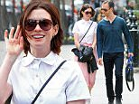 Picture Shows: Anne Hathaway, Adam Shulman  April 17, 2015\n \n Couple Anne Hathaway and Adam Shulman are spotted out for a stroll together in New York City, New York. Anne looked pretty in a pink pleated midi skirt with a white scalloped shirt and white sneakers.  \n \n Non Exclusive\n UK RIGHTS ONLY\n \n Pictures by : FameFlynet UK © 2015\n Tel : +44 (0)20 3551 5049\n Email : info@fameflynet.uk.com