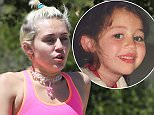 Picture Shows: Miley Cyrus  April 16, 2015    Pop star Miley Cyrus shows off her flat stomach while out for a hike with her friends in Los Angeles, California. Miley recently made headlines after wearing a see through shirt on Instagram during a raunchy impromptu photo shoot with Scout and Tallulah Willis.    Non-Exclusive  UK RIGHTS ONLY    Pictures by : FameFlynet UK © 2015  Tel : +44 (0)20 3551 5049  Email : info@fameflynet.uk.com