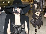 Lady Gaga wearing all black with a hat and tassels on her glasses carries her dog in her arms as she arrives at LAX  Pictured: Lady Gaga Ref: SPL1001784  170415   Picture by: SPW / Splash News  Splash News and Pictures Los Angeles: 310-821-2666 New York: 212-619-2666 London: 870-934-2666 photodesk@splashnews.com